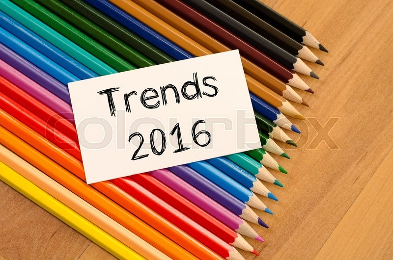 Stock image of 'Trends 2016 text concept and colored pencil on wooden background'
