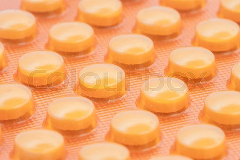 Stock image of 'orange pills in blister pack can be used as background'