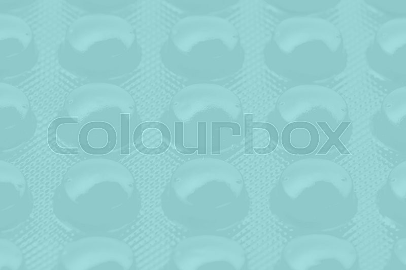 Stock image of 'blue pills in blister pack can be used as background'