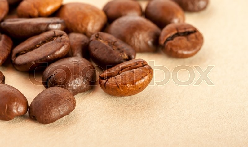 Stock image of 'coffee beans on the paper can be used as background'