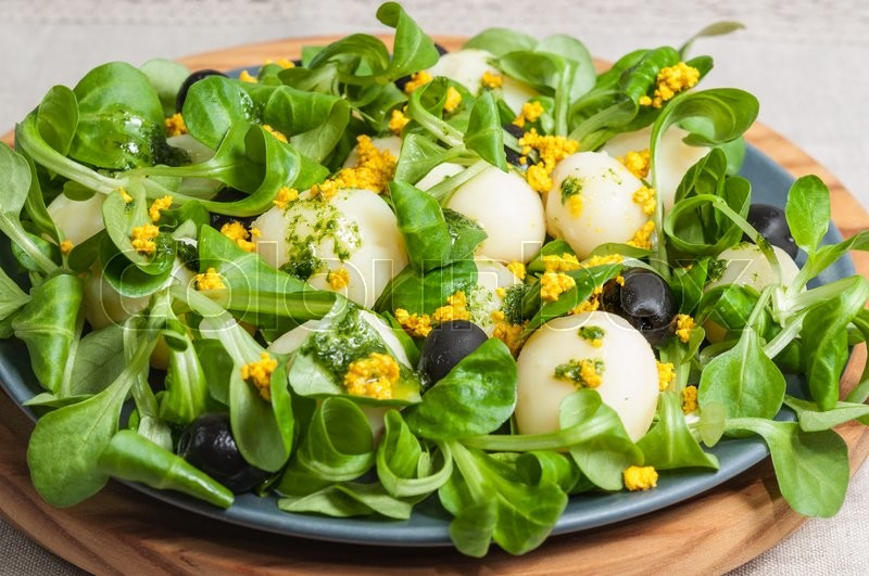 Stock image of 'Salad plate of lettuce, potatoes, tofu and turmeric'
