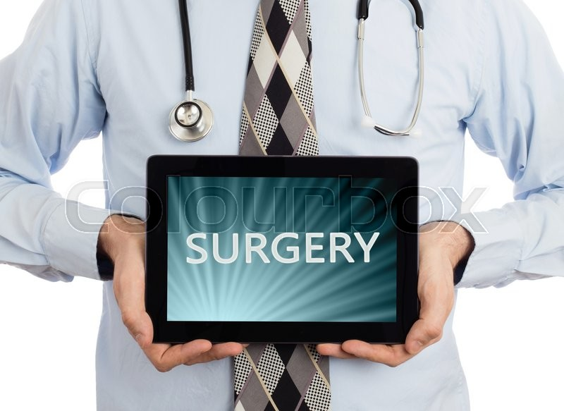Stock image of 'Doctor, isolated on white backgroun,  holding digital tablet - Surgery'