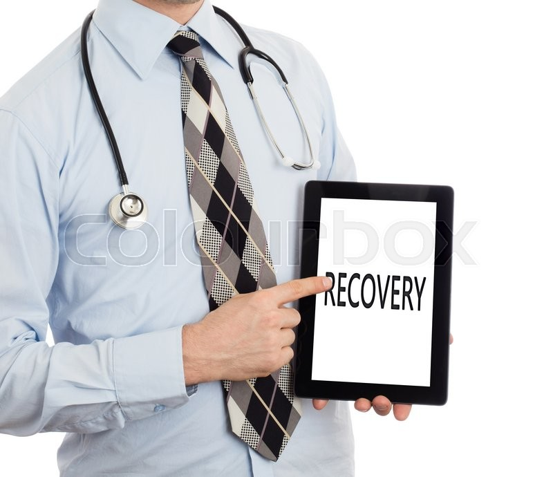 Stock image of 'Doctor, isolated on white backgroun,  holding digital tablet - Recovery'