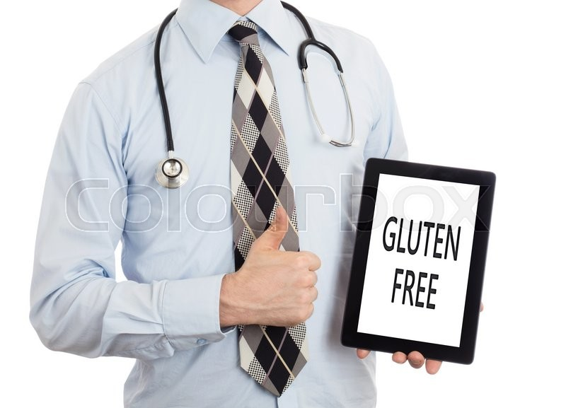 Stock image of 'Doctor, isolated on white backgroun,  holding digital tablet - Gluten free'
