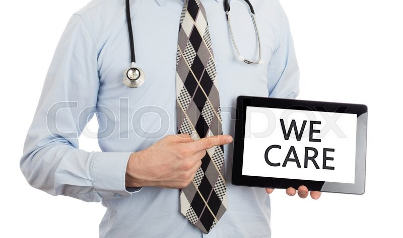Stock image of 'Doctor, isolated on white backgroun,  holding digital tablet - We care'