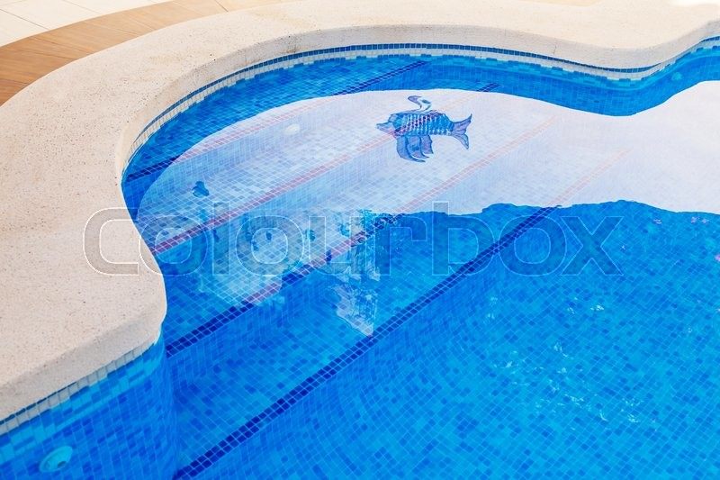 Stock image of 'Outdoor swimming pool with steps'