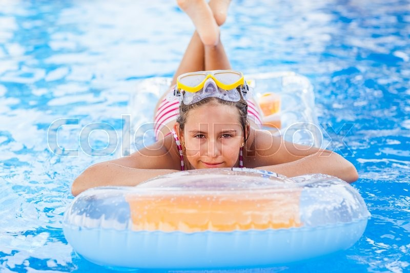 Stock image of 'Cute girl relaxing in pool'