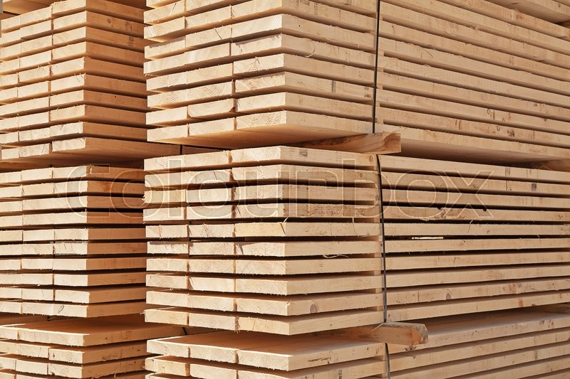 Stock image of 'Stack of new wooden studs at the lumber yard'