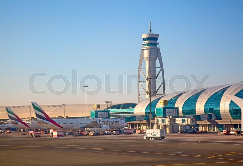 Editorial image of 'Dubai - February 20:  Planes preparing for take off at Dubai Airport on February 20, 2016 in Dubai, U.A.E. Dubai airport is home port for Emirates Airlines and one of the biggest world hubs.'