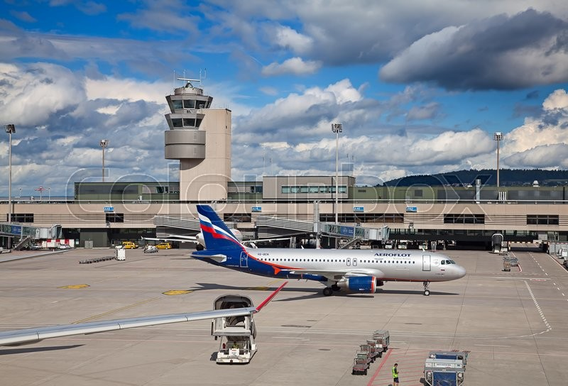 Editorial image of 'ZURICH - September 21:  Planes preparing for take off at Terminal A of Zurich Airport on September 21, 2014 in Zurich, Switzerland. Zurich airport is home port for Swiss Air and one of the biggest european hubs.'