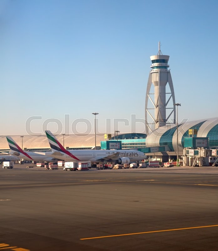 Stock image of 'Dubai - February 20:  Planes preparing for take off at Dubai Airport on February 20, 2016 in Dubai, U.A.E. Dubai airport is home port for Emirates Airlines and one of the biggest world hubs.'