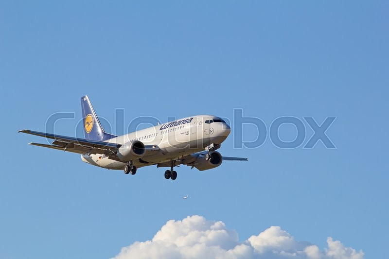 Editorial image of 'ZURICH - JULY 18: Boeing-737 Lufthansa landing in Zurich after short haul flight on July 18, 2015 in Zurich, Switzerland. Zurich airport is home for Swiss Air and one of biggest european hubs.'