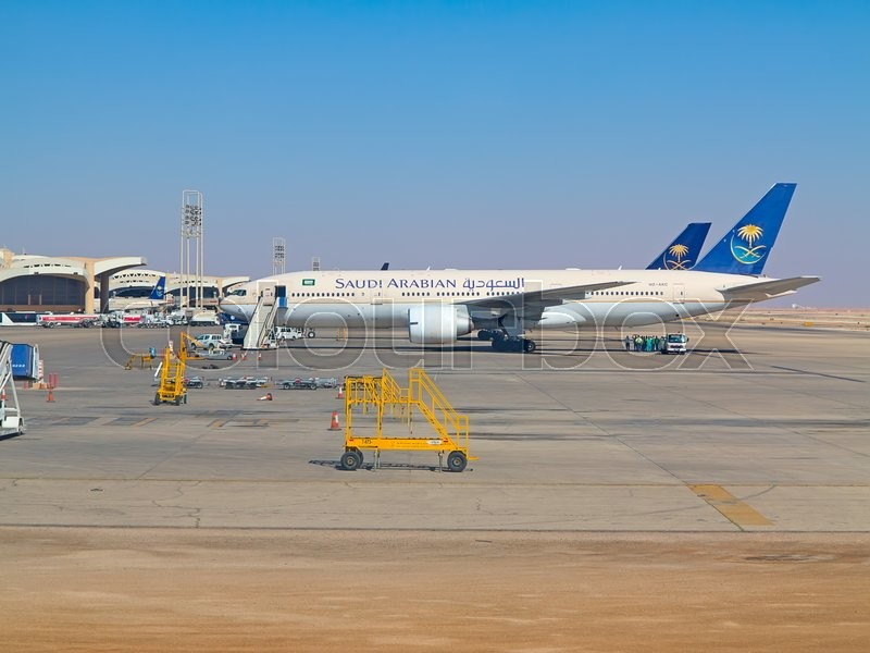 Editorial image of 'Riyadh - March 01:  Planes preparing for take off at Riyadh King Khalid Airport on March 01, 2016 in Riyadh, Saudi Arabia. Riyadh airport is home port for Saudi Arabian Airlines.'