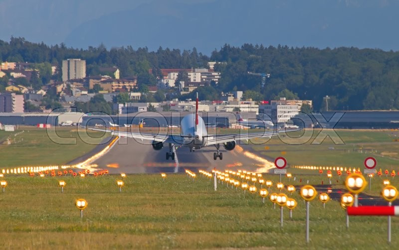 Stock image of 'ZURICH - JULY 18: Swiss A-320 landing in Zurich airport after short haul flight on July 18, 2015 in Zurich, Switzerland. Zurich airport is home port for Swiss Air and one of the biggest european hubs.'