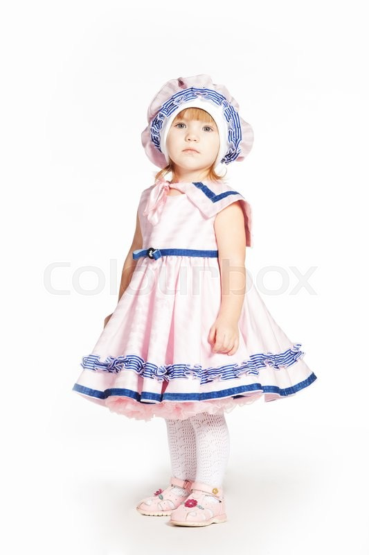 Stock image of 'Little girl in a pink dress lake a sailor'