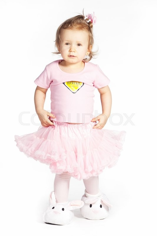 Stock image of 'Little girl in a pink clothes isolated on white '