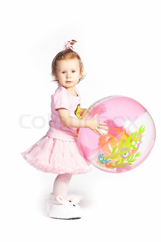 Stock image of 'Little girl in a pink clothes with big ball'
