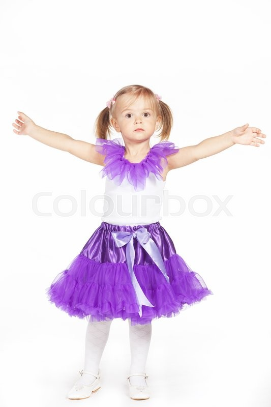 Stock image of 'Little girl in a purple skirt isolated on white '
