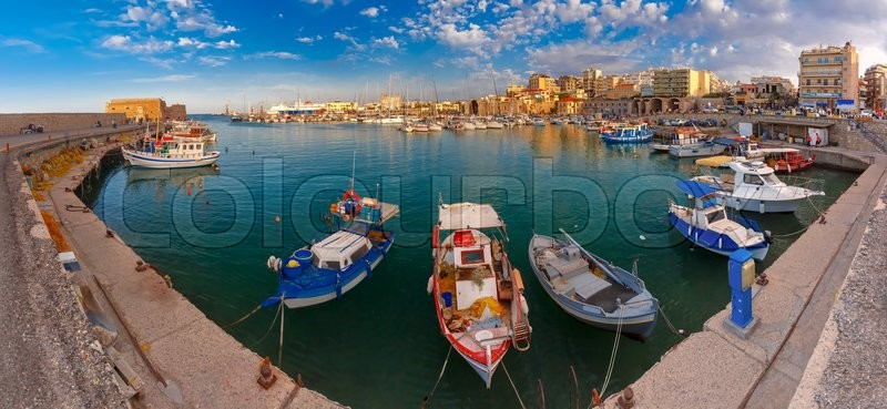 Stock image of 'Panorama of Old harbour with fishing boats and marina in the summer sunny morning, Heraklion, Crete, Greece. '