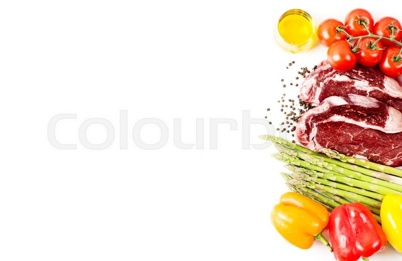 Stock image of 'Raw steak with vegetables and spices isolated on white with copy space'