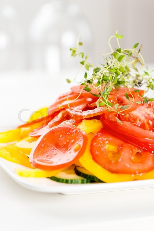 Stock image of 'Vegetable salad on white plate'