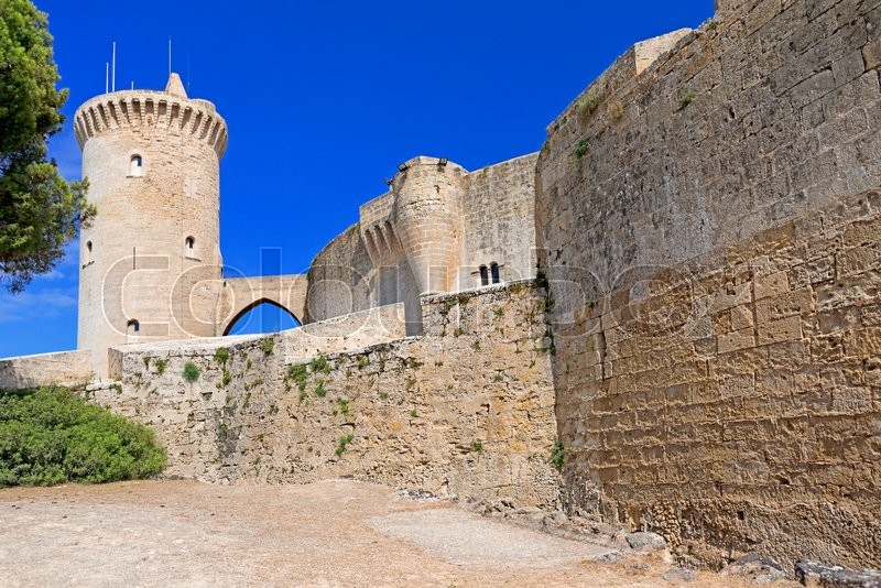 Stock image of 'The famous Bellver Castle fortress in beautiful sunset light against blue sky, in Palma-de-Mallorca, Spain. Travel destination, landmarks of Palma de Mallorca'