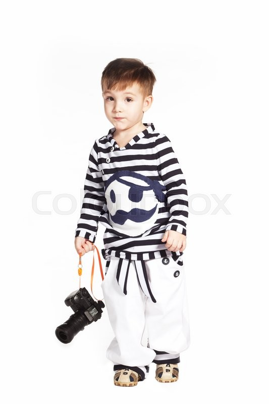 Stock image of 'Boy in the sailor suit with camera in his hands'