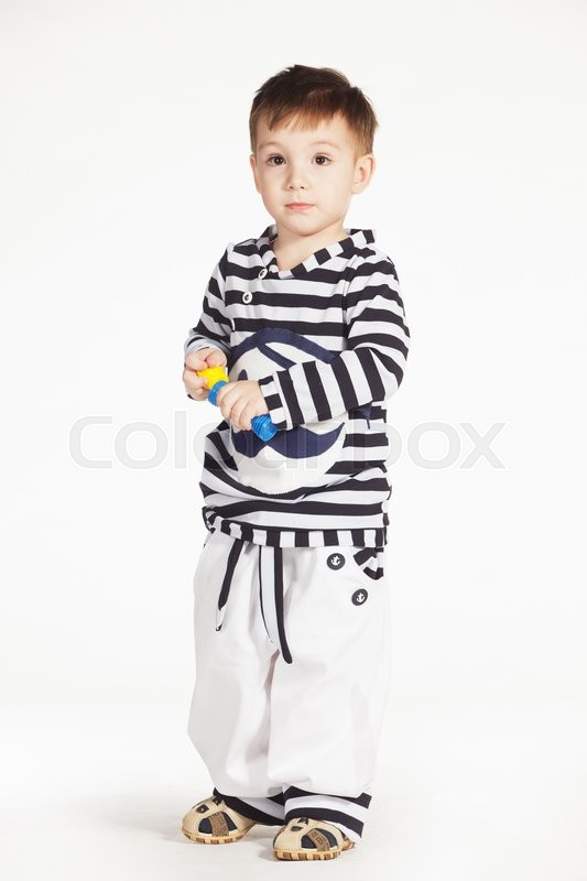 Stock image of 'Boy in the sailor suit with soap bubbles in his hands'