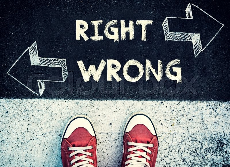 Stock image of 'Student standing above the wrong and right sign,dilemma concept '