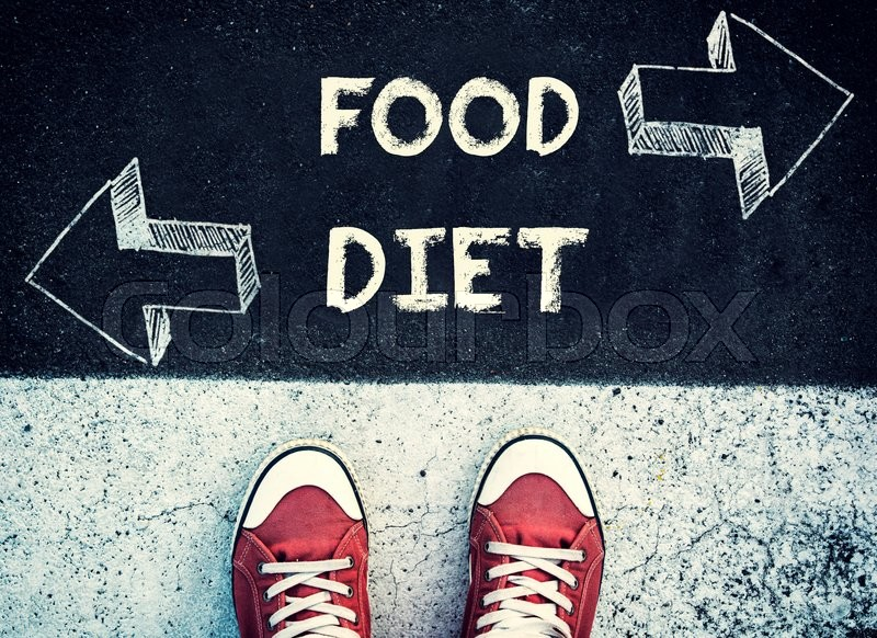 Stock image of 'Student standing above the food and diet sign,dilemma concept '