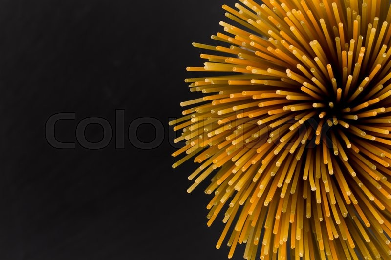 Stock image of 'Bunch of raw italian pasta with vegetable dye of spinach, paprika and carrot'
