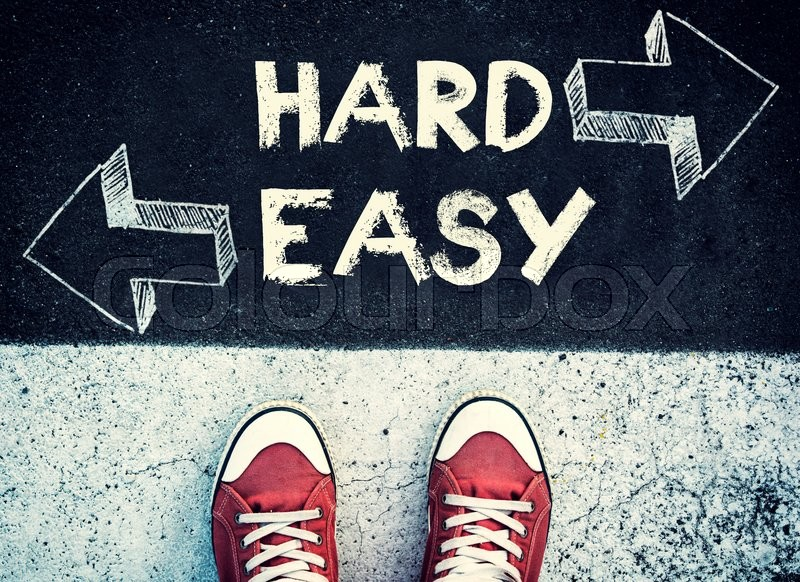 Stock image of 'Student standing above the hard and easy sign,dilemma concept '