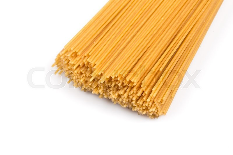 Stock image of 'Organic whole wheat spaghetti pasta on white background'