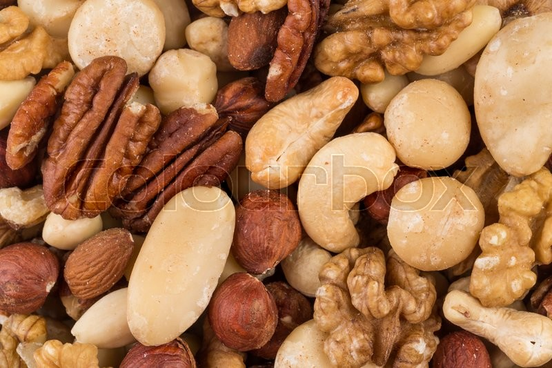 Stock image of 'lot of different types of nuts mix for background'