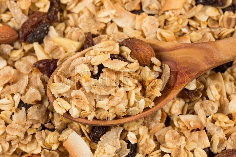 Stock image of 'Top close view of a dry mix of fruit and almon nuts cereal and spoon'