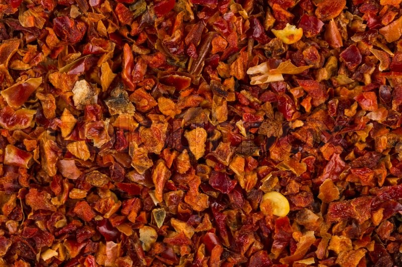 Stock image of 'Crushed red chili pepper for background texture'