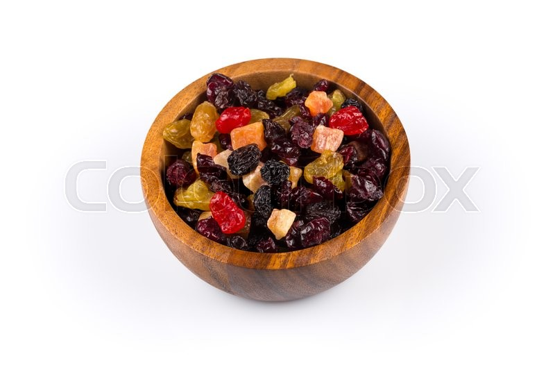 Stock image of 'Mix variety of dried fruit in wooden bowl over white background'
