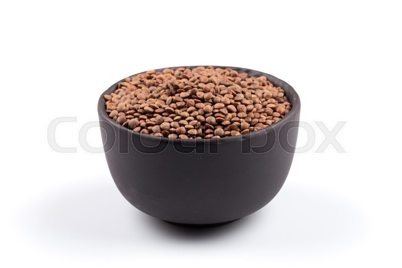 Stock image of 'Organic lentils in bowl Isolated on a white background - close up shot'