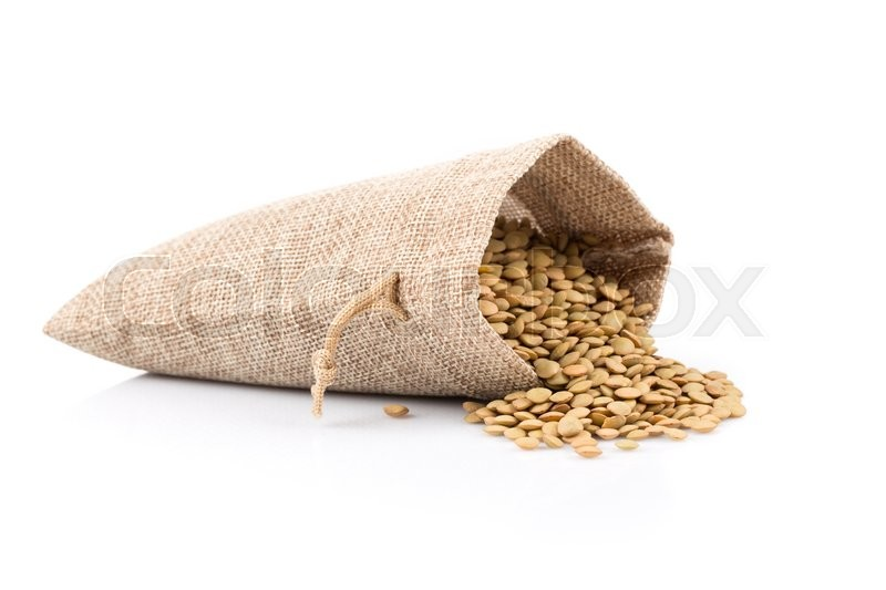 Stock image of 'French green lentils (lentilles du Puy) in a burlap bag on a white background'