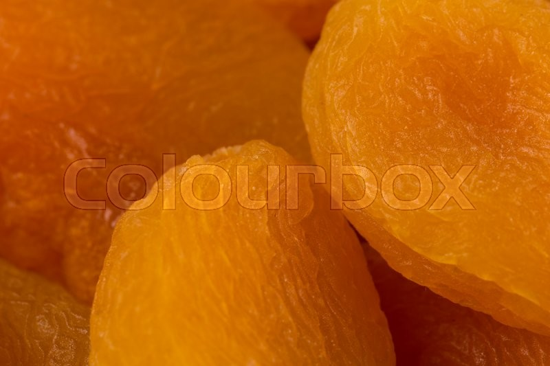 Stock image of 'Heap of dried apricots macro  close-up shot'