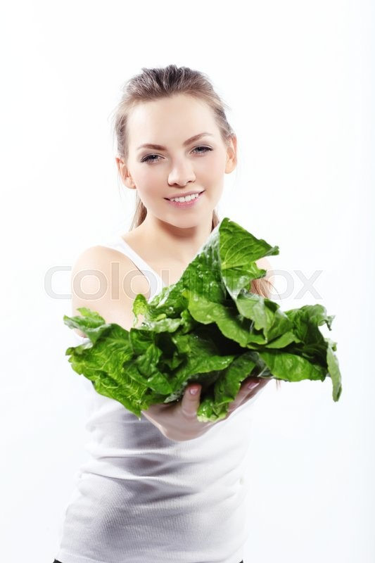 Stock image of 'Girl holding a green salad isolated on white '
