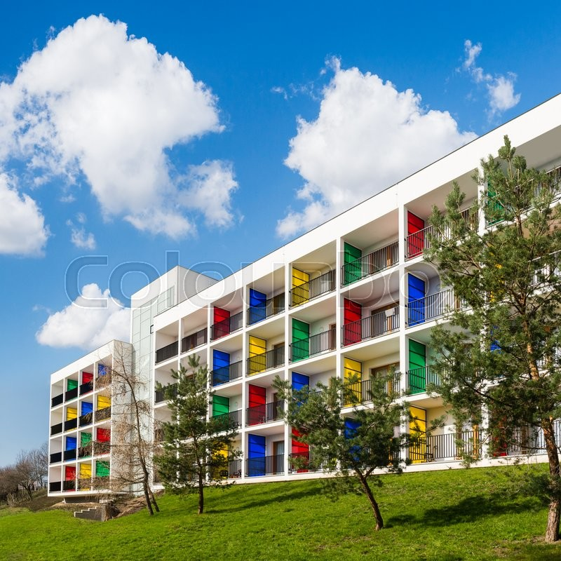 Stock image of 'Modern block of flats with colorful balconies. Green living. Modern architecture.'