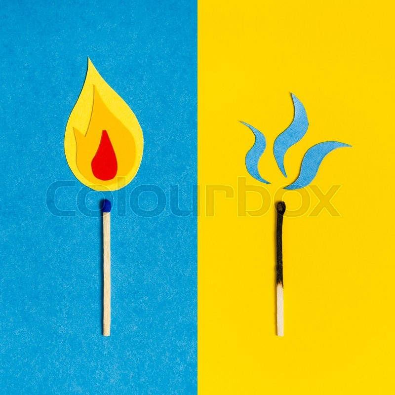Stock image of 'Two safety matches on colorful paper background. Burning match on blue background. Burnt out match on yellow background.'