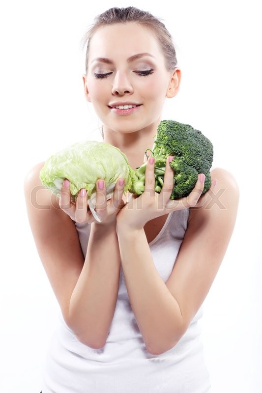 Stock image of 'Girl holding a green cabbage and broccoli isolated on white '