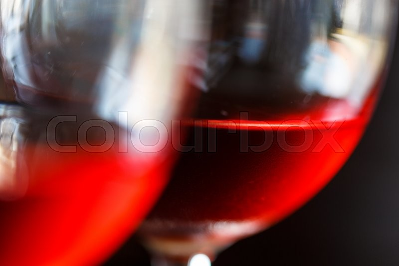 Stock image of 'Macro view of a red wine in a glass'
