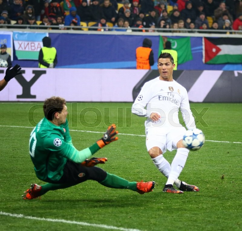 Editorial image of 'LVIV, UKRAINE - NOVEMBER 25, 2015: Cristiano Ronaldo of Real Madrid (in White) kicks the ball during UEFA Champions League game against FC Shakhtar Donetsk at Arena Lviv stadium'