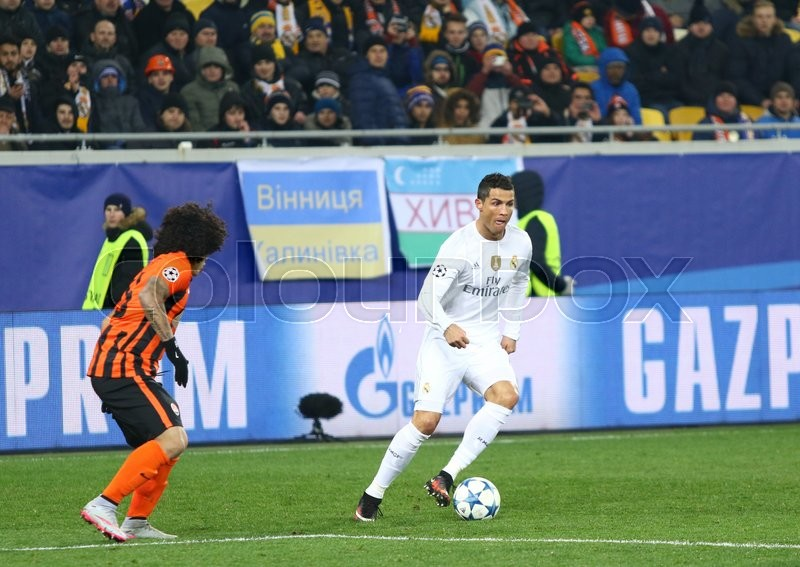 Editorial image of 'LVIV, UKRAINE - NOVEMBER 25, 2015: Cristiano Ronaldo of Real Madrid (R) in action during UEFA Champions League game against FC Shakhtar Donetsk at Arena Lviv stadium'