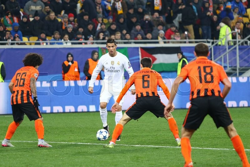 Editorial image of 'LVIV, UKRAINE - NOVEMBER 25, 2015: Cristiano Ronald of Real Madrid (in White) fights for a ball with Shakhtar Donetsk players during their UEFA Champions League game at Arena Lviv stadium'