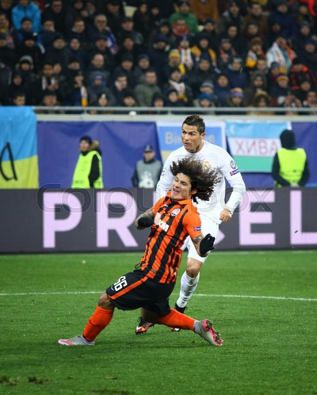 Editorial image of 'LVIV, UKRAINE - NOVEMBER 25, 2015: Cristiano Ronaldo of Real Madrid (in White) fights for a ball with Marcio Azevedo of Shakhtar Donetsk during their UEFA Champions League game at Arena Lviv stadium'
