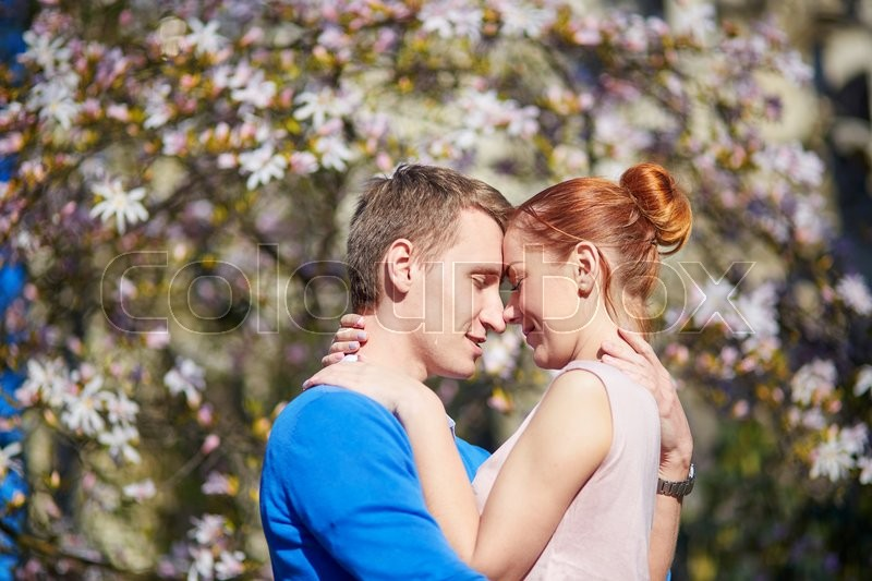 Stock image of 'Romantic couple in flowering garden in Paris, France'